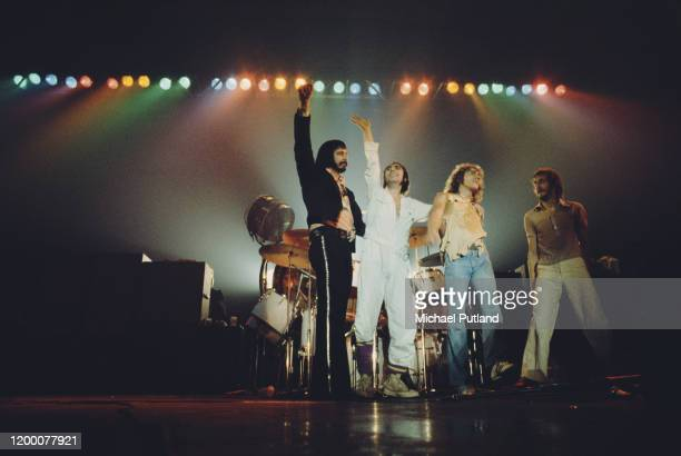 Band members of English rock group The Who wave to the audience after performing on stage at Wembley Empire Pool in London in October 1975. The band...