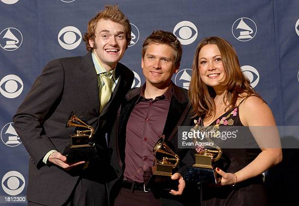 Band members of Nickel Creek pose backstage during the 45th Annual Grammy Awards at the Madison Square Garden on February 23 2003 in New York City