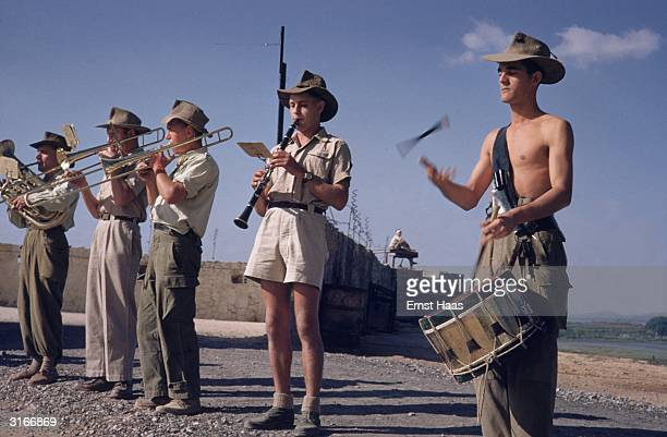 Band members of the French Foreign Legion stage an informal performance in the former Indochina