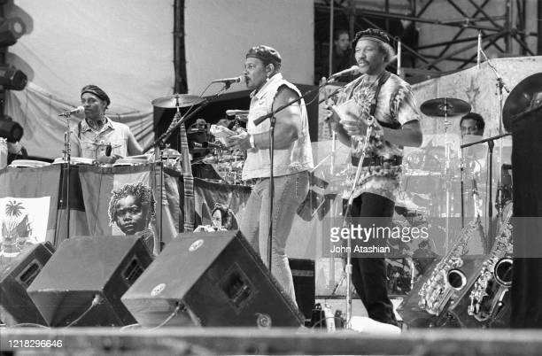 Band members of the Neville Brothers are shown performing on stage at Woodstock '94 on August 14, 1994.