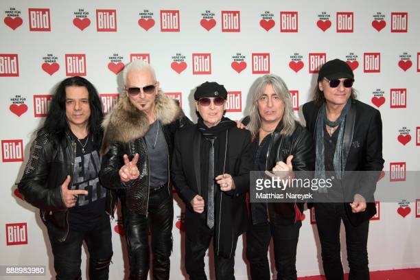 Band members of the Scorpions attend the Ein Herz Fuer Kinder Gala at Studio Berlin Adlershof on December 9 2017 in Berlin Germany