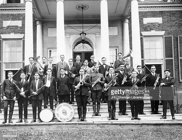 Band Members posed on Gilman Hall steps with instruments Johns Hopkins University Baltimore Maryland 1922 Bottom Row Burgess Jennings James E Mount...