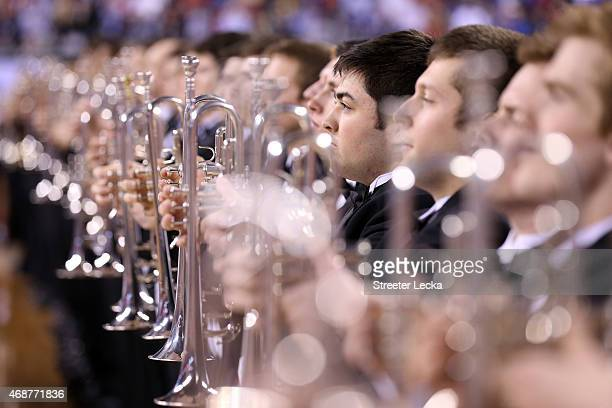 Band members prepare to play the national anthem before the game between the Duke Blue Devils and the Wisconsin Badgers during the NCAA Men's Final...