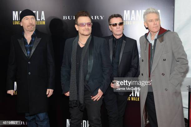 U2 band members The Edge Bono Larry Mullen Jr and Adam Clayton attend Mandela Long Walk To Freedom screening hosted by U2 Anna Wintour Bob and Harvey...
