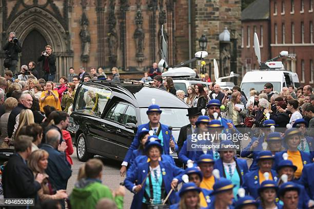 A band of drummers lead the funeral cortege of teenage cancer fundraiser Stephen Sutton as it leaves Lichfield Cathedral on May 30 2014 in Lichfield...