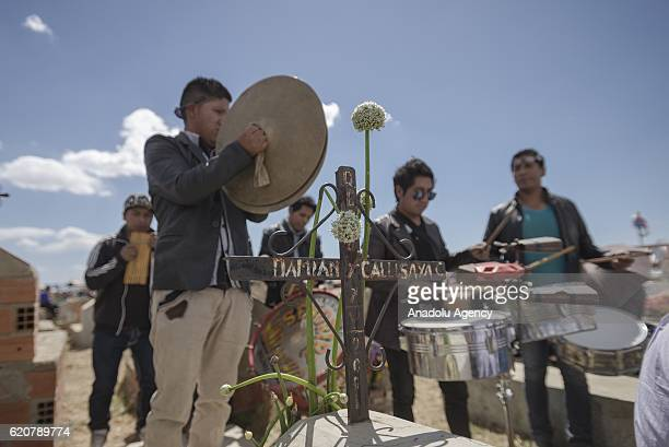 A band of musicians dedicate a popular song to a deceased during the Day of the Dead festivity at Mercedario cemetery in the city of El Alto Bolivia...
