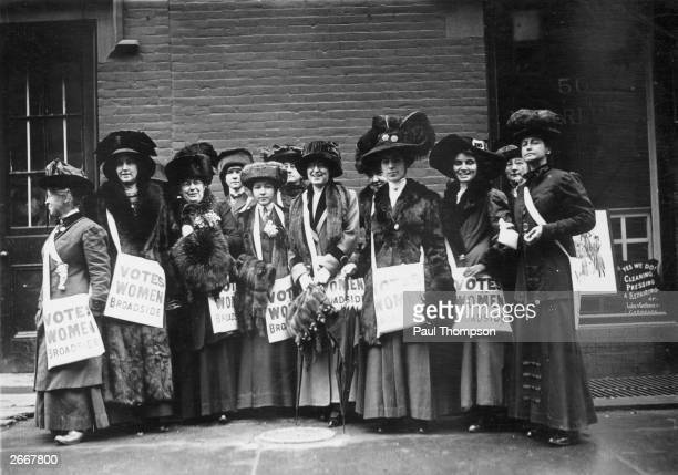 A band of 'news girls' of the Women's Suffrage Movement prepare to invade New York's Wall Street armed with leaflets and slogans demanding votes for...