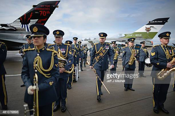 Band of the Royal Air force join personnel from 617 squadron the Dambusters and their sister squadron 12 prepare to take part in a disbandment parade...