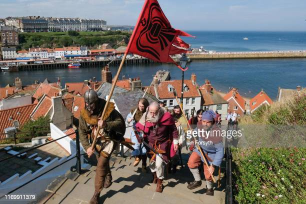 A band of vikings march up the 199 steps during the Viking Festival at Whitby Abbey on August 24 2019 in Whitby England Temperatures are expected to...