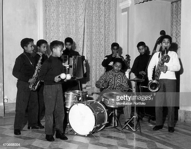 'A band of young musicians all lined up testing themselves with musical instruments at the Village of the Children a care center for abandoned...