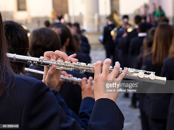Band on the street, woman playing flute