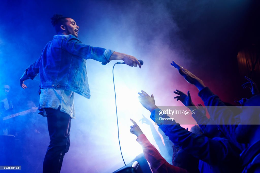 Band performing on stage at music concert : Stock Photo