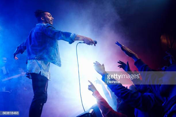 band performing on stage at music concert - singer stock pictures, royalty-free photos & images