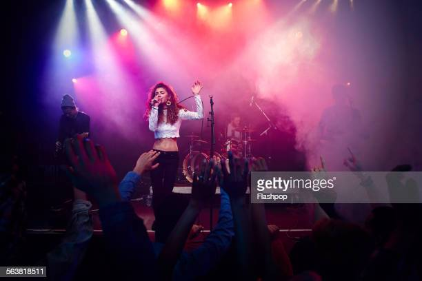band performing on stage at music concert - performance group stock pictures, royalty-free photos & images