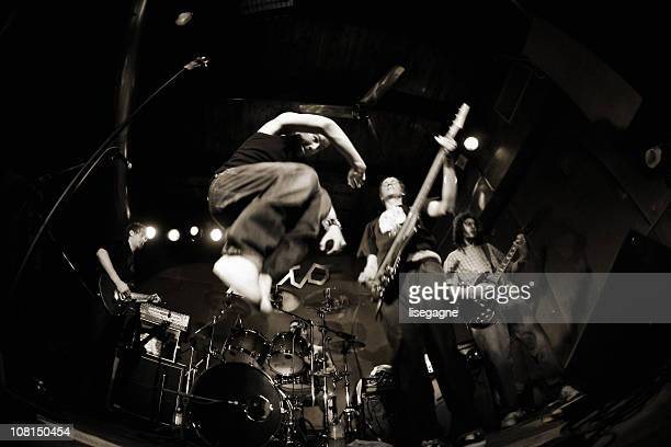 Band performing on stage, fisheye