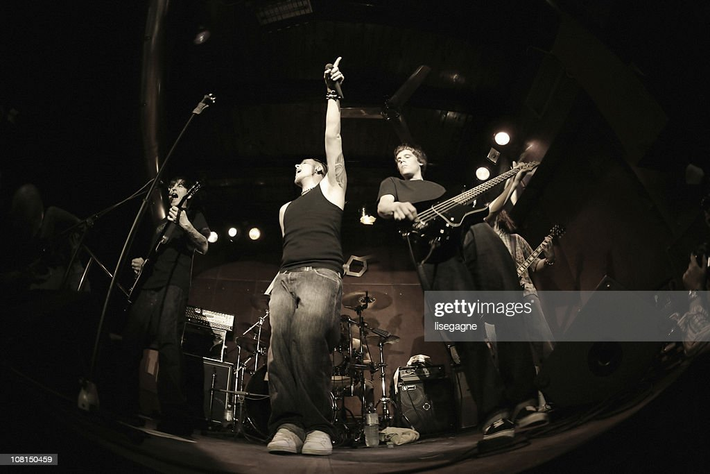 Band performing on stage, fisheye : Stock Photo