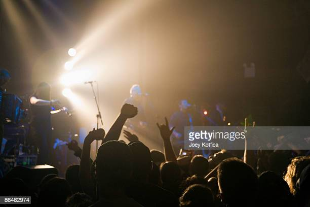 band performing on stage - modern rock stock pictures, royalty-free photos & images