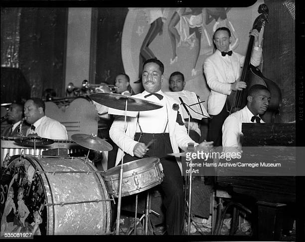 Band performing with Leroy Brown on saxophone on left James 'Honey Boy' Minor playing drums Erroll Garner on piano 'Wimpie' Mosby Joe Westray and...
