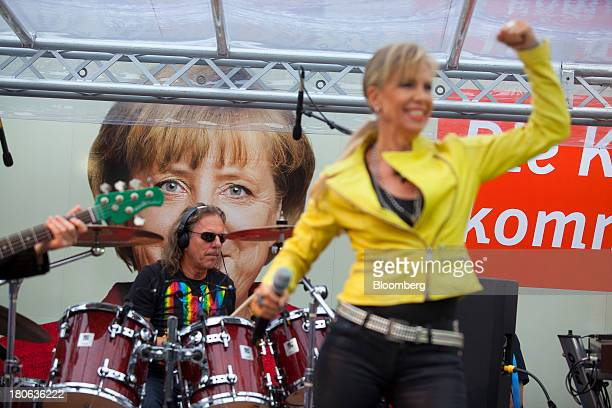 A band performs before Angela Merkel Germany's chancellor and party leader of the Christian Democratic Union speaks during an election rally in...