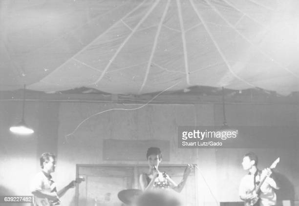 A band performs for members of the United States military inside of a large temporary building in Vietnam during the Vietnam War 1966
