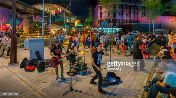 A band performs outside Bukit Bintang shopping area