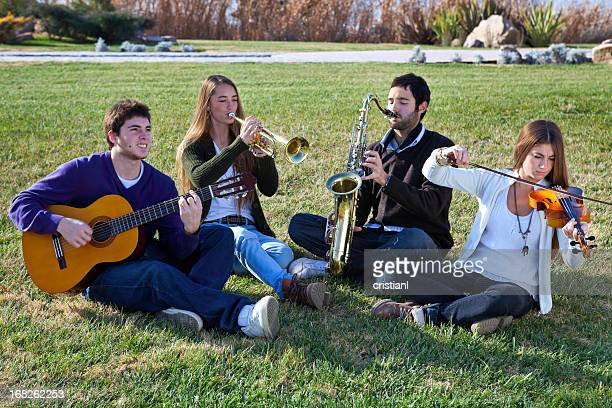 band - musical quartet stock photos and pictures