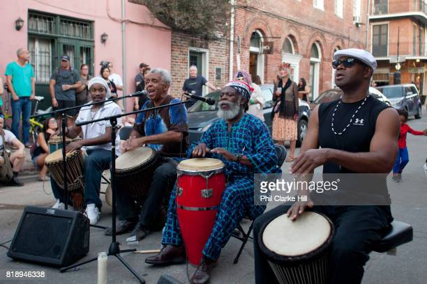 A band playing at a voodoo cultural event in the street French Quarter New Orleans Louisiana USA walking down the street in the French Quarter
