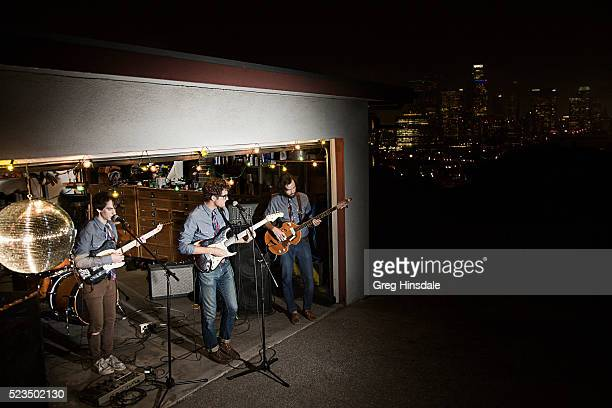 band playing in garage - garage band stock photos and pictures