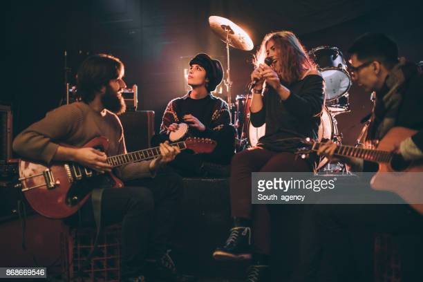 band playing in the club - performance group stock pictures, royalty-free photos & images