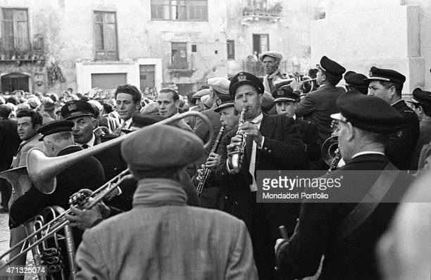 A band playing on a square of the city Agrigento 1950s