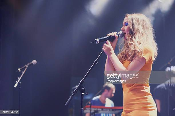 her voice is heavenly - blonde female singers stock photos and pictures