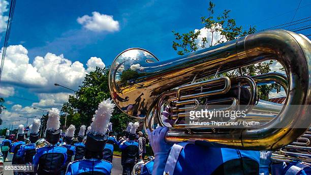 band playing tuba during parade on street - parade stock pictures, royalty-free photos & images