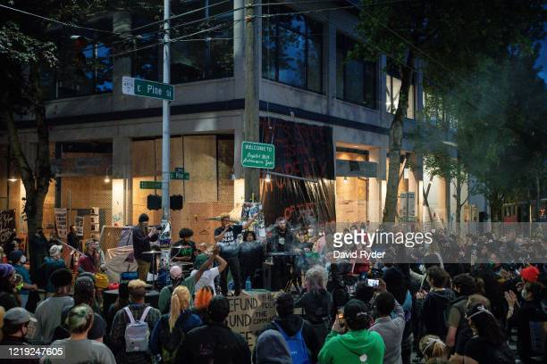 "Band plays a free show in front of the Seattle Police Departments East Precinct in the so-called ""Capitol Hill Autonomous Zone"" on June 10, 2020 in..."