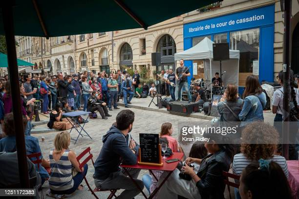 Band plays in Île de la Cité as Paris celebrates the first day of summer with Fete de La Musique, with bands playing across the city on June 21, 2020...