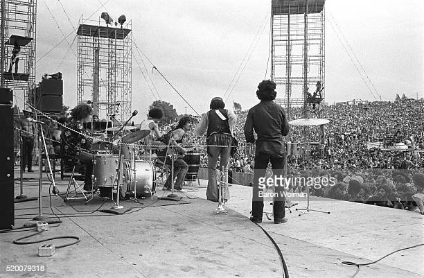 A band plays on stage at the Woodstock Music Festival Bethel NY August 15 1969