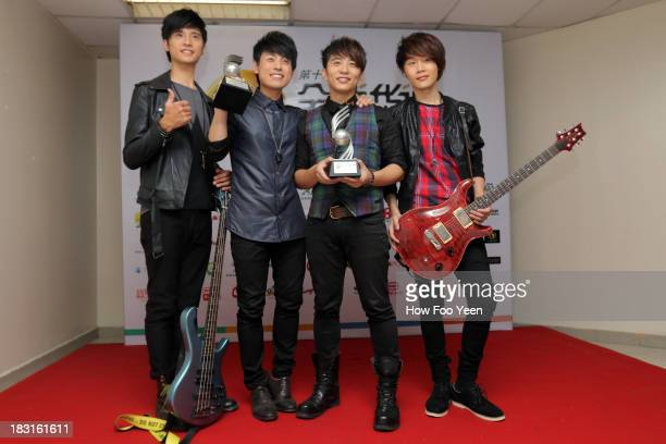 Band poses with their Most Popular Band Award at back stage during the 13th Global Chinese Music Awards at Putra Stadium on October 5 2013 in Kuala...