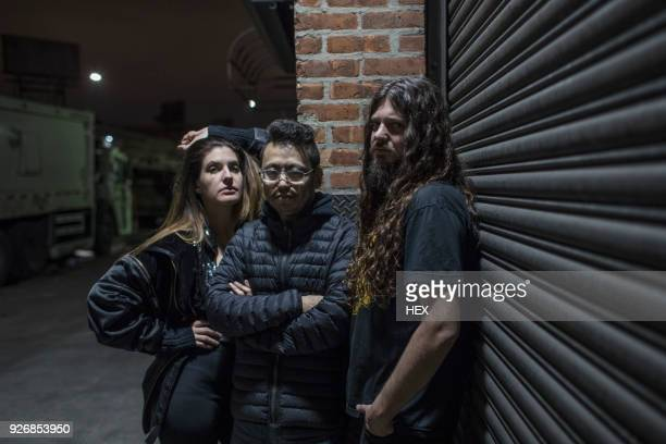 band posing for portrait on a street at night - the doors band stock pictures, royalty-free photos & images