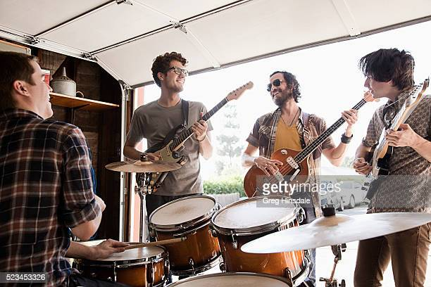 band practicing in garage - garage band stock photos and pictures