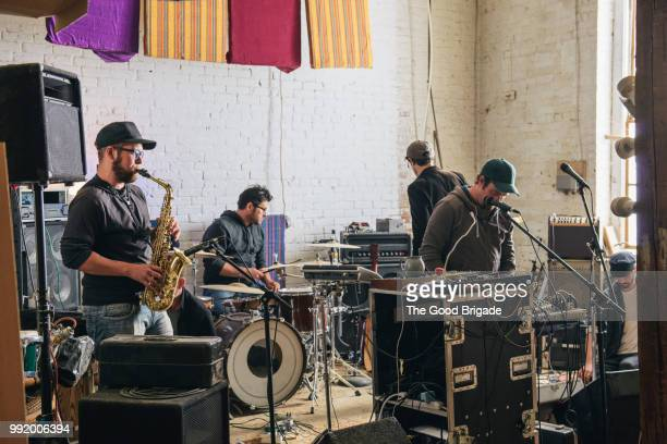 band practicing with musical instruments in recording studio - recording studio stock pictures, royalty-free photos & images