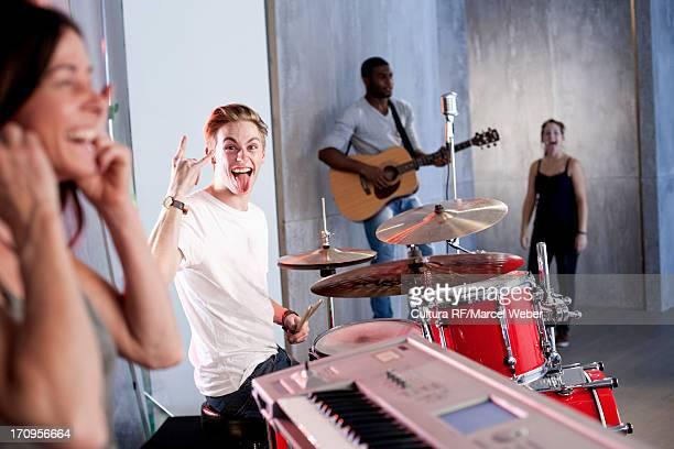 Band practising in recording studio