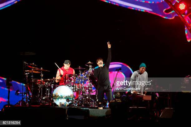 US band Red Hot Chili Peppers perform on stage during the Lollapalooza music festival at the Longchamp Hippodrome in Paris on July 23 2017 / AFP...