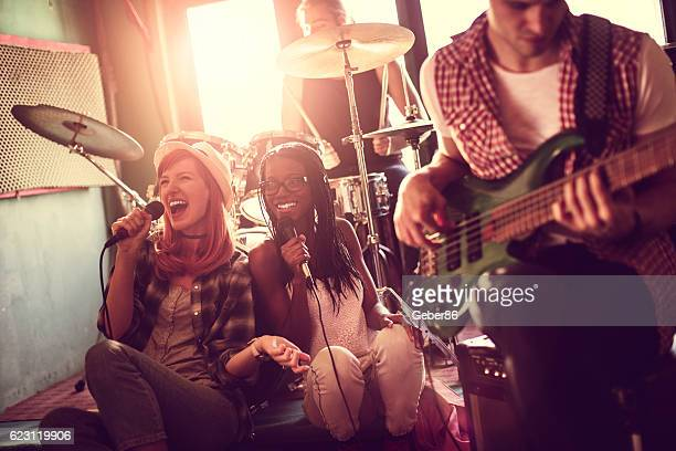 band rehearsing in a studio - plucking an instrument stock pictures, royalty-free photos & images