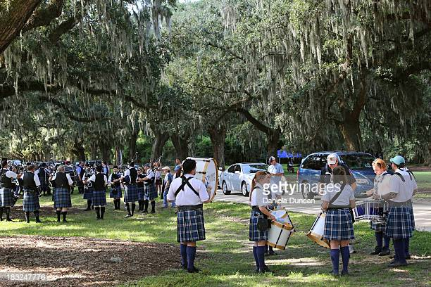 CONTENT] Band rehearsing under ancient old trees at the entrance of the historic Boone Hall Plantation during the Highland Games Highland games...