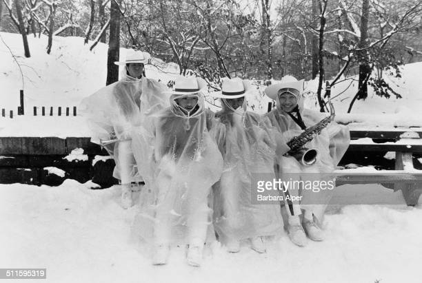 A band takes a break during a record snowfall in Central Park during the Thanksgiving Day Parade New York City 23rd November 1989