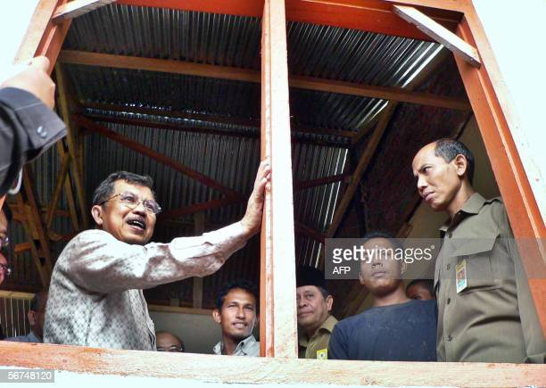 Banda Aceh, INDONESIA: Indonesian Vice President Jusuf Kalla stand inside a newly-built house in Banda Aceh 05 February 2006. Kalla told officials in...