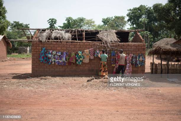 Banda clothing vendors display their merchandise at Awatche market on March 17 2019 In Awatche village Banda farmers and hunters live now in harmony...