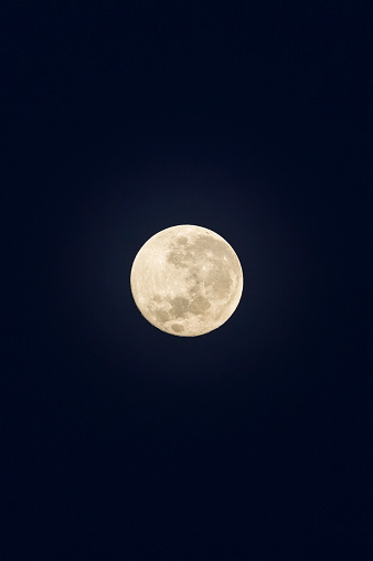 The craters and textures of a full moon in a night sky. - gettyimageskorea