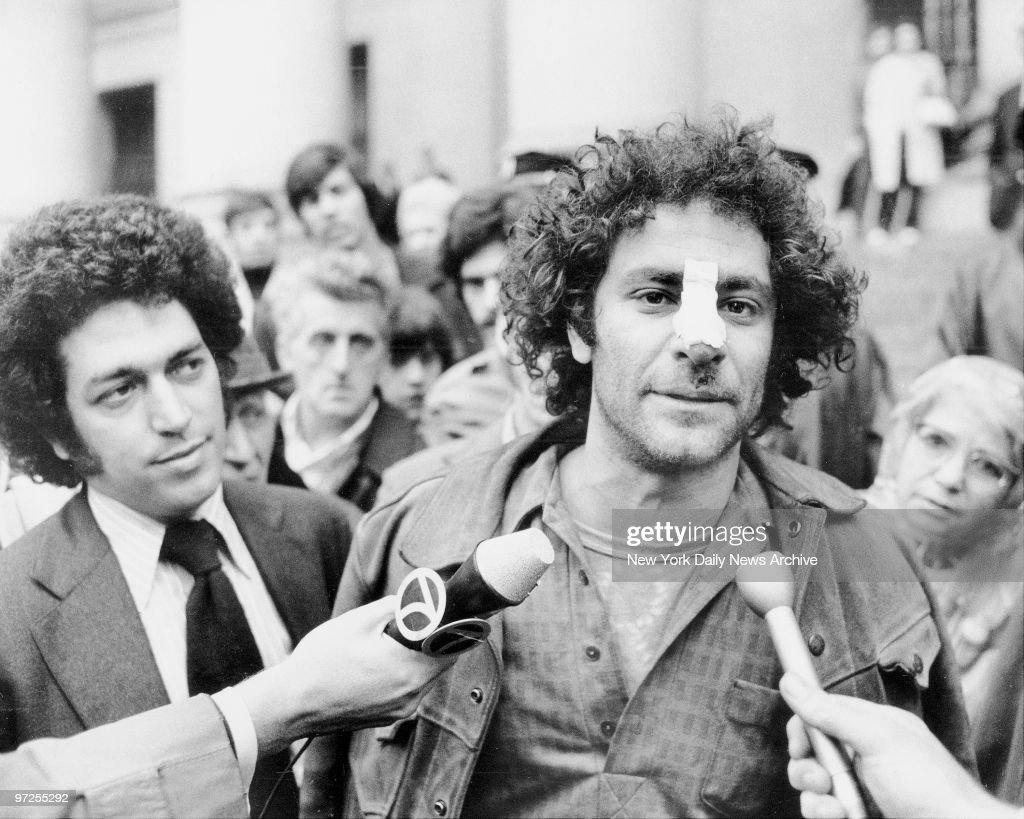 Bandage adorns the nose of Yippie Abbie HOffman as he leaves : News Photo
