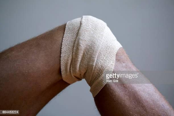 bandage on knee - elastic bandage stock photos and pictures