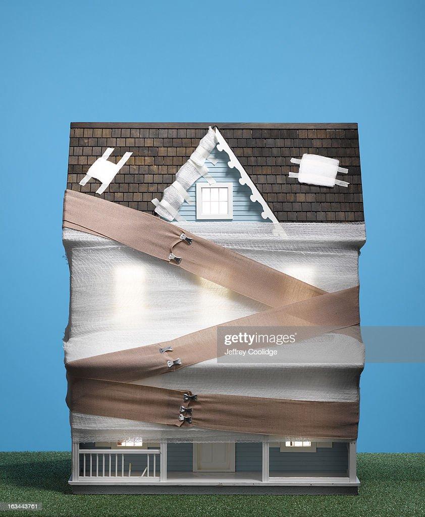 Bandaged Dollhouse : Stock Photo